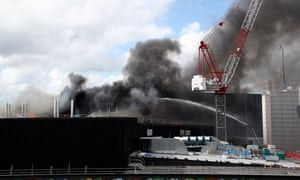 Firefighters battle flames coming from the roof of the SkyCity Convention Centre