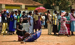 Ugandan voters who were unable to vote the first day, queue outside polling stations in Kampala on Friday.