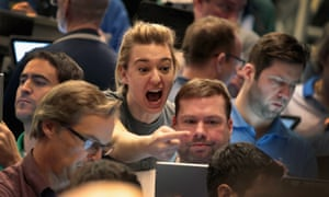 Traders react to market volatility on the floor of the Cboe in Chicago.