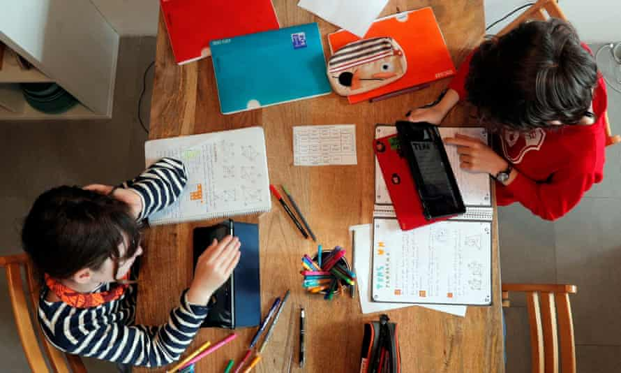 Children seen working at home from above