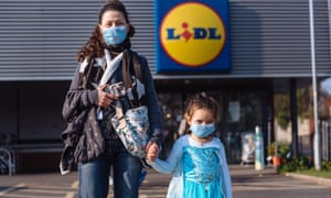 mother and daughter wearing face masks outside a lidl supermarket