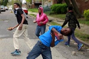Children throw rocks