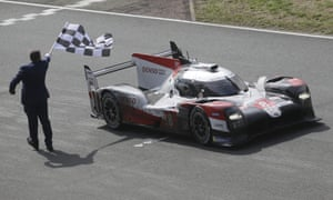 The Toyota TS050 Hybrid No 8 of the Toyota Gazoo Racing Team crosses the finish line to win the 88th Le Mans race
