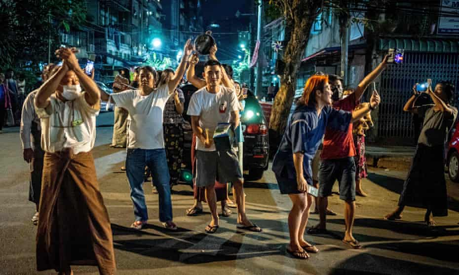 People make noise on a street in Yangon after calls for protest went out on social media
