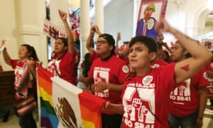 Demonstrators march in the Texas Capitol on Monday.