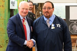 Louie Kamookak receives the Polar Medal from the governor general.