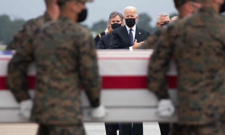Joe Biden attends the dignified transfer of the remains of fallen service members at Dover Air Force Base in Delaware.