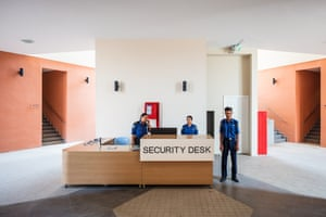 """Star City in Yangon, Myanmar. Longitude: 96¡ 22' 93.73"""" Guards at a security desk in the residential blocks of Star City, a new development targeting middle- and high-income residents"""
