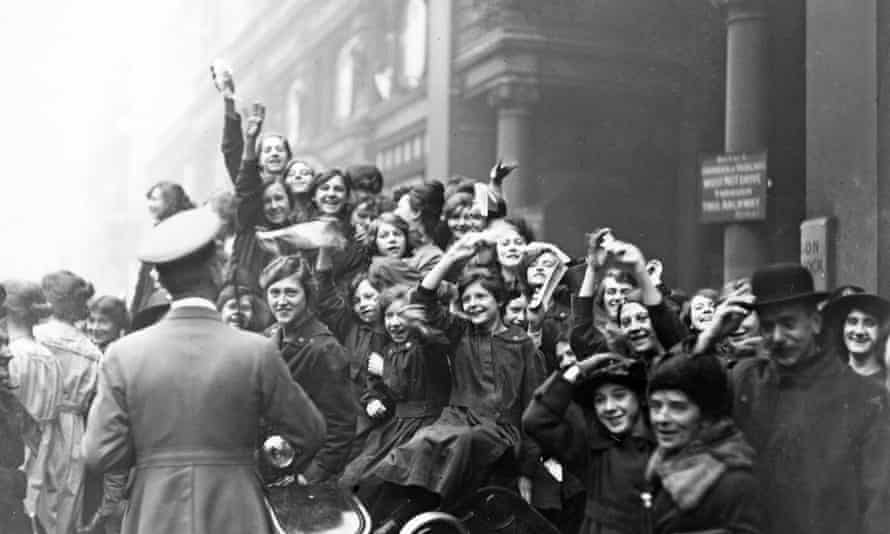 Crowds in London celebrate the Armistice at the end of the first world war, November 1918.