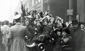Londoners celebrate the Armistice in 1918 – the image we used to illustrate the cover of our supplement.