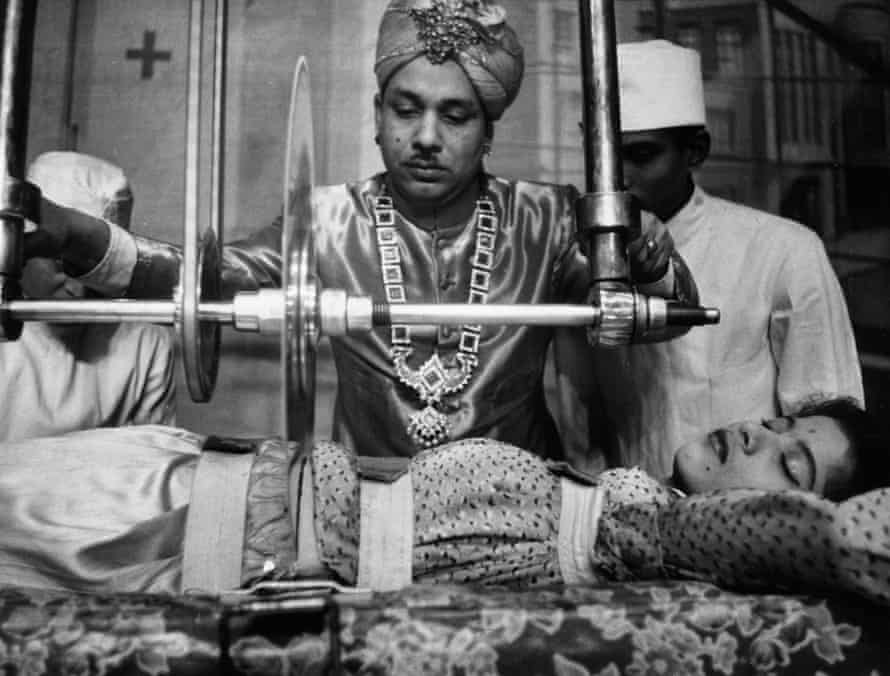The Great Sorcar prepares to cut a woman in half in 1956.