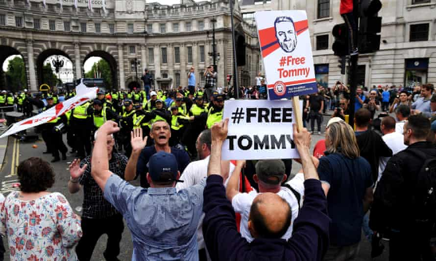 Demonstrators and police at a protest against the jailing of Tommy Robinson in central London