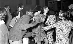 Hippies dance at a psychedelic rock concert at the Fillmore auditorium in San Francisco, California.