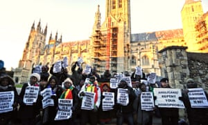 Protesters demonstrate in front of Canterbury Cathedral