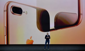Tim Cook, the Apple chief executive, against backdrop of new Apple product