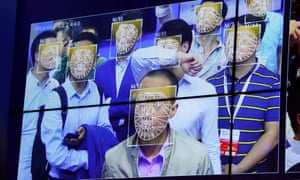 Visitors experience facial recognition technology at the Face++ booth at the Public Security Expo in Shenzhen, China.