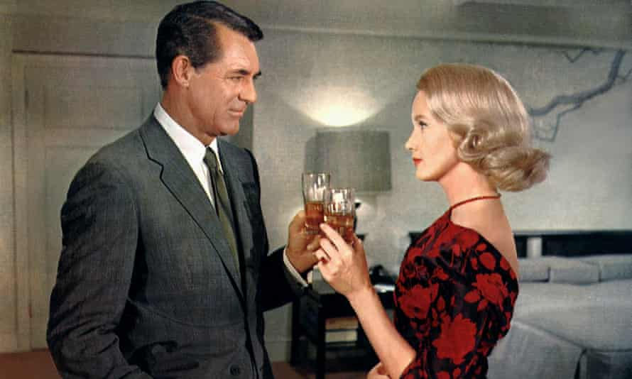Cary Grant in his Savile Row suit in North by Northwest, with Eva Marie Saint.
