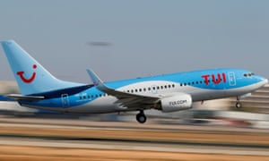 A TUI fly Belgium Boeing 737 airplane takes off from the airport in Palma de Mallorca.