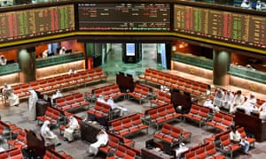 Traders sit and observe developments in the trading hall of the Kuwait stock exchange in Kuwait City