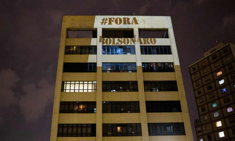 Images are projected on building walls against President of Brazil Jair Bolsonaro during a televised speech on March 18, 2020 in Sao Paulo
