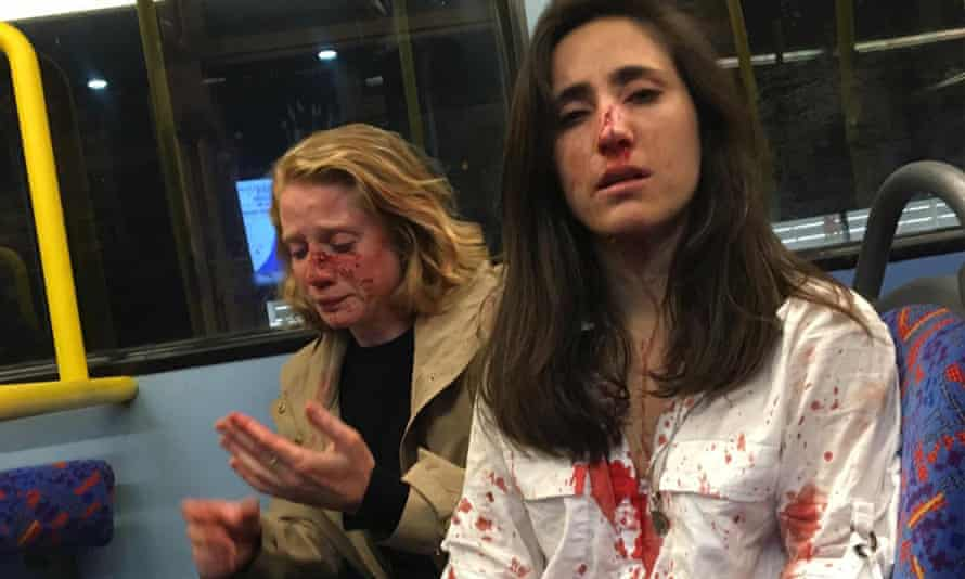 Melania Geymonat (R) and her girlfriend, Chris, who were attacked on a night bus