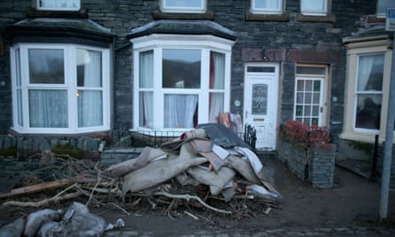 Rubbish is piled as the people of Keswick begin the clean-up after flood damage caused by Storm Desmond.