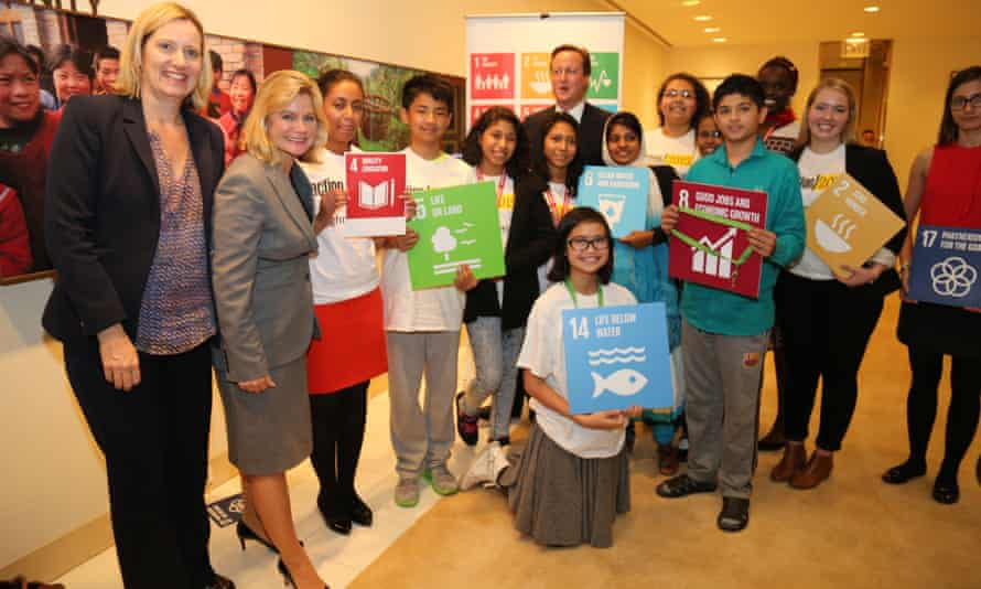 David Cameron, the UK prime minister, with development secretary Justine Greening and young people at the UN general assembly in New York on 27 September 2015.
