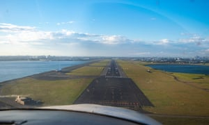A hobby pilot prepares to land his plane at Sydney airport on Sunday