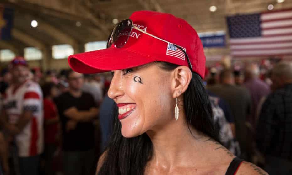 Trump supporter Shadow Lane sports the 'Q' for QAnon.