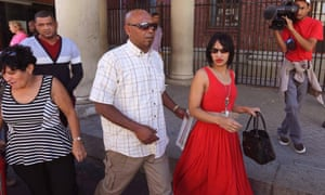 Celeste Nurse, in red, and her husband, Morné, far left, leave court in Cape Town after the woman accused of kidnapping their daughter 17 years ago was remanded in custody for a week.