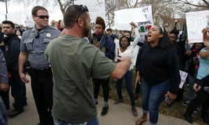 An anti-Trump protester, right, and a Trump supporter confront one another