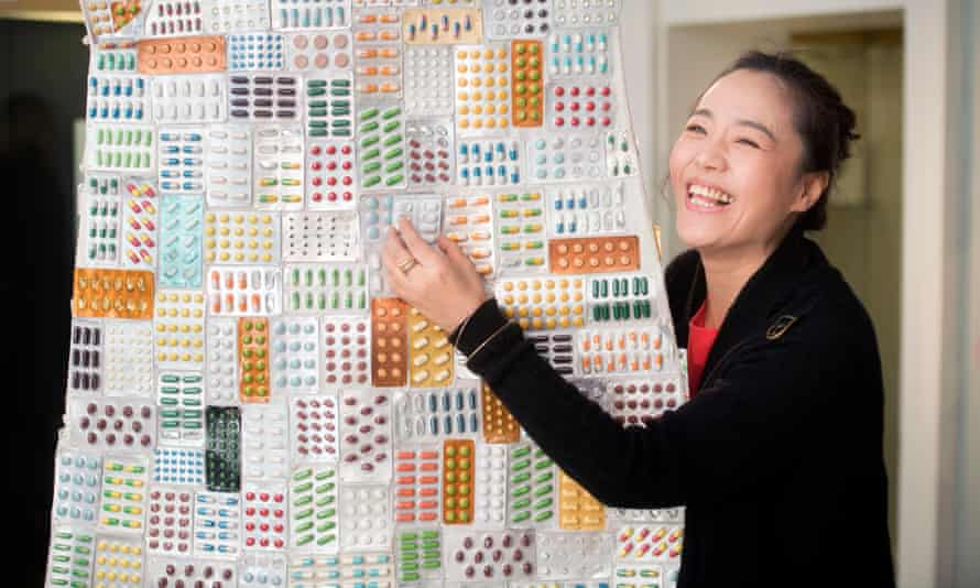 Artist Zhang Yanzi with her sculpture 'Excess' at the Museum of East Asian Art where she is contributing to an exhibition of contemporary Chinese Art.