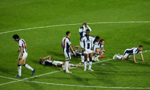 Dejected players of West Bromwich Albion react after losing on penalties.