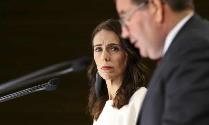 New Zealand's prime minister, Jacinda Ardern, looks on while Finance Minister Grant Robertson speaks during a press conference on 9 March 2020 in Wellington