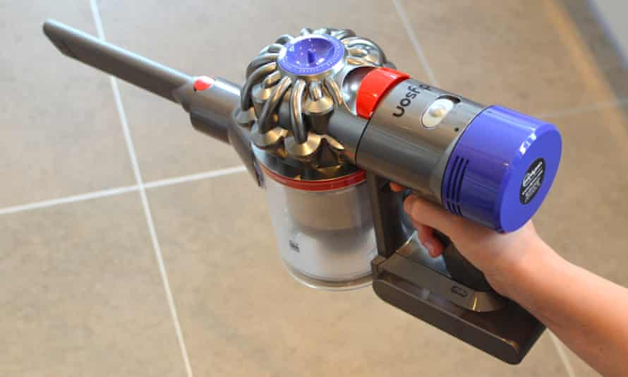 A Dyson handheld cleaner pointing left