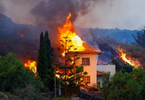 A house burns after lava poured through the area