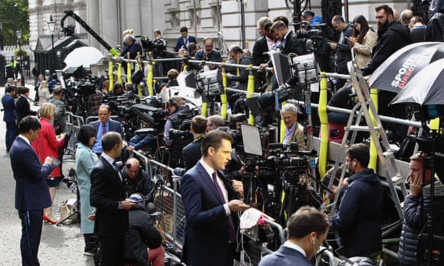 Journalists outside Downing Street.