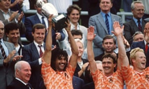 Former Netherlands player Ruud Gullit (second left) lifts the European championship trophy in 1988