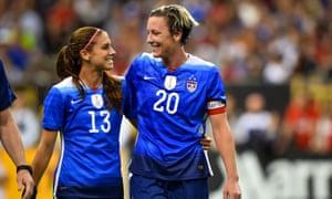 Alex Morgan and Abby Wambach share a smile despite USA's 1-0 defeat by China.