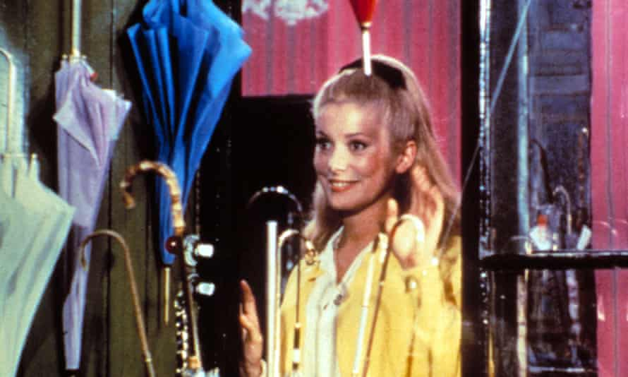 Catherine Deneuve in The Umbrellas of Cherbourg, with music by Legrand.
