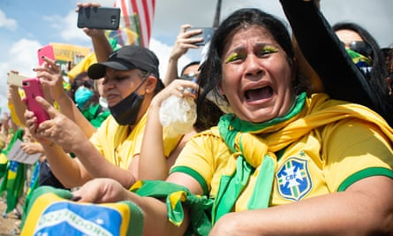 Supporters of Brazil's president, Jair Bolsonaro, wearing the national football team's shirts at a demonstration in Brasilia.