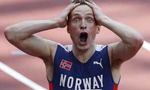 Karsten Warholm celebrates winning the gold medal and setting a new world record in the 400m hurdles.