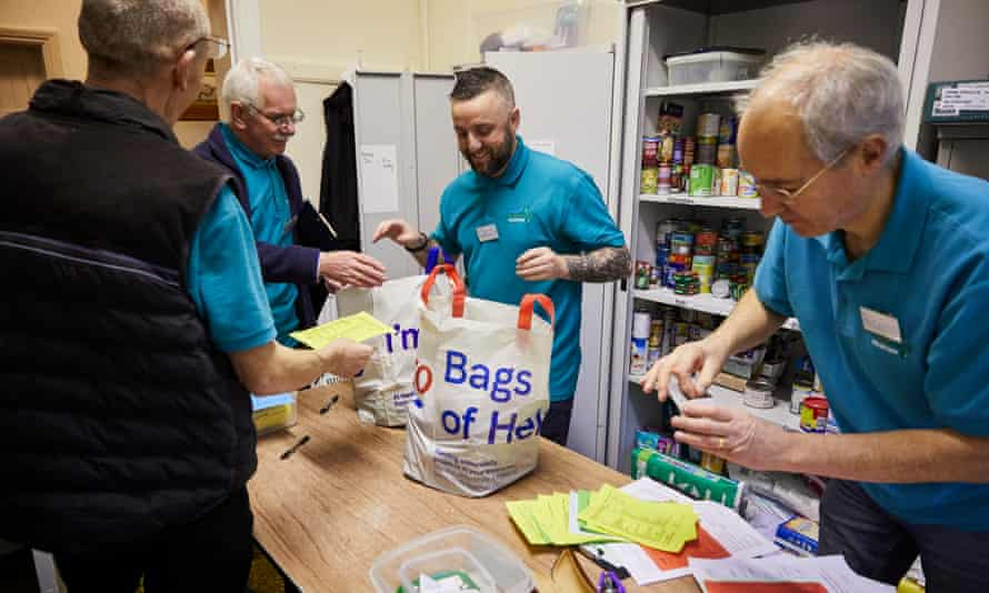 People stock up on supplies at one of 15 Trussell Trust emergency food banks in and around Birkenhead