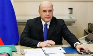 Russia's prime minister Mikhail Mishustin holds a government meeting via video link from the House of Government.