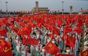 Chinese students who were to sing as a choir wave party and national flags at a ceremony marking the 100th anniversary of the Communist Party