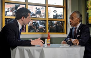 Buttigieg and Sharpton at Sylvia's. 'The scene brought to mind an eager sales rep trying to foist a new line of faucets on a department store owner.'