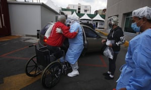 A health worker helps Luis Reyes into a car, to be taken home after recovering from Covid-19, outside the Mexico City Ajusco Medio General Hospital, Wednesday, 2 December, 2020.