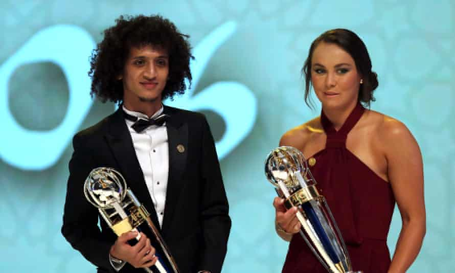 Omar Abdulrahman and Caitlin Foord pose with their Footballer of the Year trophies