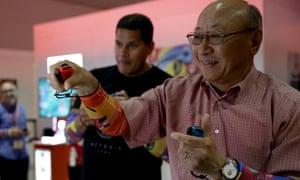 Nintendo global president Tatsumi Kimishima (R) and Nintendo of America president Reggie Fils-Aime play Arms at E3 2017.