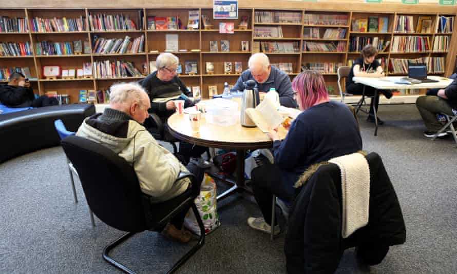 A local book group meeting at Huddersfield library before lockdown. Librarians are keeping in touch with local residents.